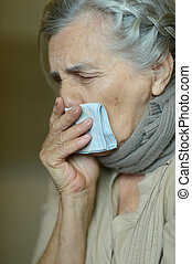 woman fells ill - Mature woman fells ill a cold at home