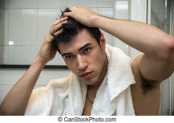 Gorgeous Man after his Shower Holding his Head - Close up...