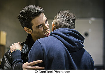Hungry Young Male Vampire Bites Man Neck