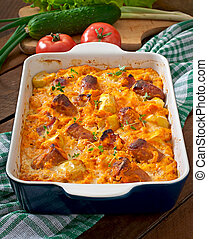 Casserole with sausage, bacon and apples in a pumpkin-cheese...