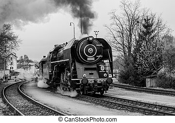 Old steam train in black and white