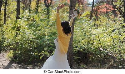 Bride swirl around herself - Happy bride outdoor