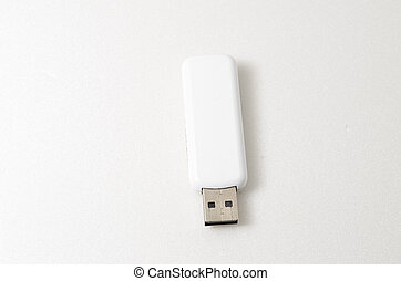 White USB Pendrive. Shoot over white background. Shallow...
