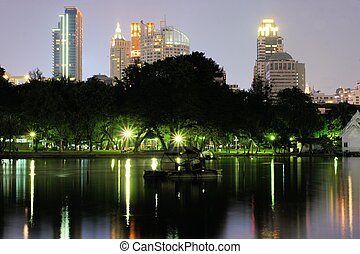 Business district cityscape, Lumphini park, Bangkok,...