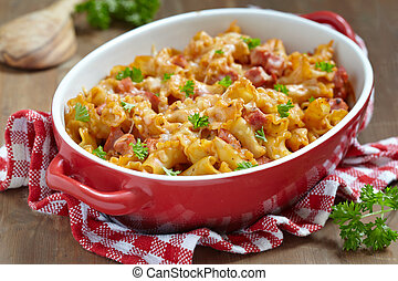 pasta casserole with cheese and ham with tomato and cream...