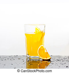Splashing orange drink with orange on white background