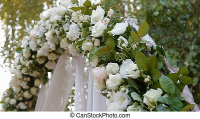Wedding arch with natural roses, ivory color