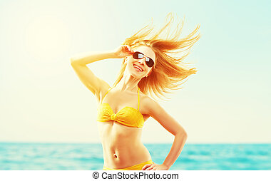 beautiful young woman with hair flying in the wind and...