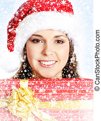 Portrait of young and beautiful girl with a big present over Chr