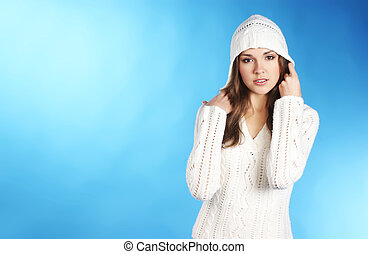young pretty woman in winter dress