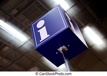 tourist information sign in a station with neon lights in...