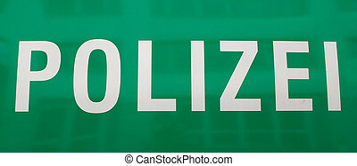 "detailed view on a text on a german police car ""polizei\"""