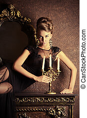 vintage interior - Elegant young woman in black evening...