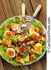 Salad Caesar with mushrooms, eggs, chili and radish with two...
