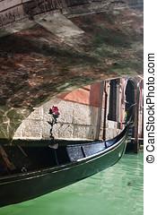 Gondola under bridge - Gondola boat moored under old bridge...