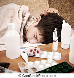 Sick Teenager sleep on the Sofa with Pills on foreground
