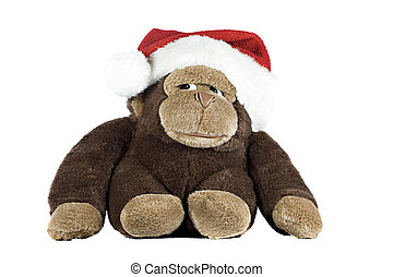 Santa hat - A toy gorilla wearing a santa hat isolated on...