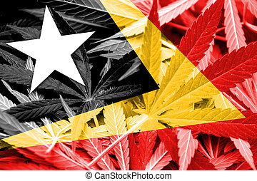 East Timor Flag on cannabis background. Drug policy....