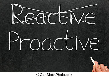 Crossing out reactive and writing proactive on a blackboard