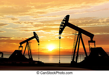 silhouette of oil pumps - silhouette of working oil pumps on...