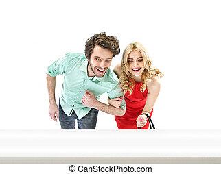Portrait of an amazed couple