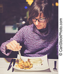 Dining in italian restaurant - Cheerful young lady having...