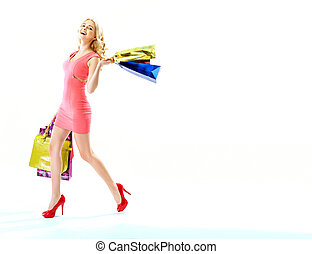 Delighted woman with lots of shopping bags - Delighted young...