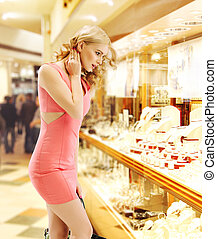 Pretty lady looking at the shop window