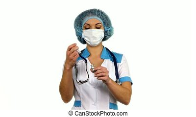 Healthcare and medicine: nurse using a syringe on white background.
