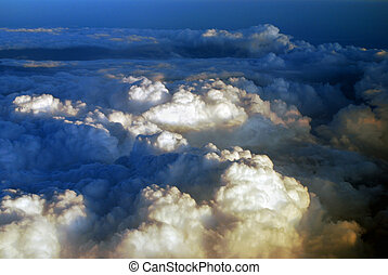 aerial view over the clouds at sunset