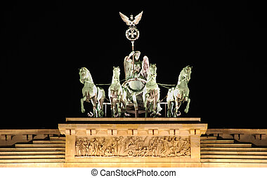 berlin brandenburg gate by night with the quadriga sculpture