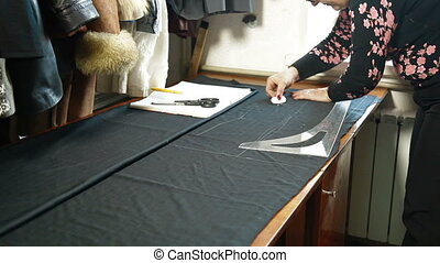 Custom Tailor Working In Workshop