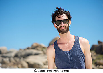 Attractive young man with sunglasses outdoors