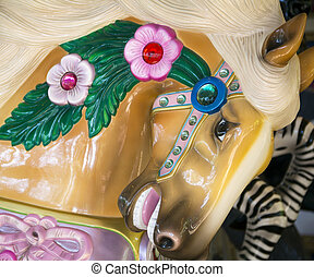 Close up of a jeweled carousel horse
