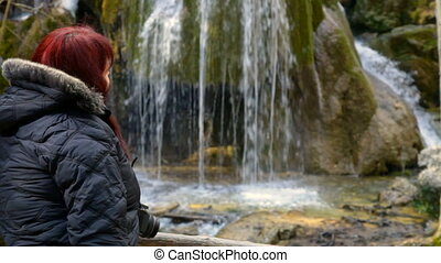 Hiker looking at a mountain waterfall Silver Jets in the forests of Crimea