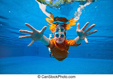 Boy swimming underwater - Cute boy underwater in swimming...