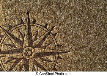 Compass rose on wood texture - A compass rose imprinted on a...