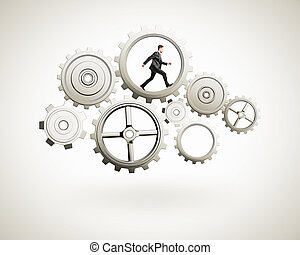 businessman runs in gears on white background
