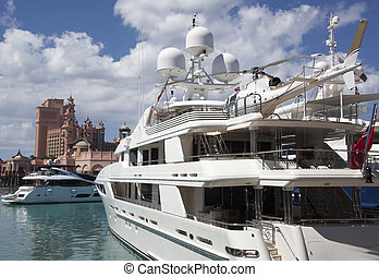 Luxury Boats - Luxury boat with a helicopter on a top in...