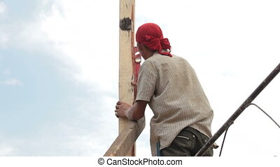 Builder worker at roofing construction works