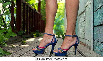 Young woman in fashionable high heeled platform shoes...