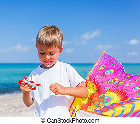 Boy with kite - Summer vacation - Portrait of cute boy...
