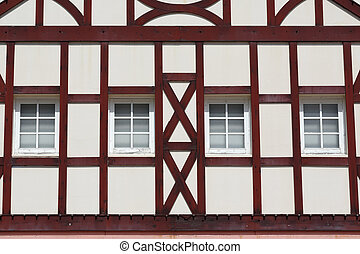 building with wooden beams - detail of pattern building...
