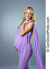 Pregnant woman - Young beautiful pregnant woman in violet...
