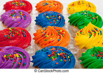 multi-colored cupcakes with sprinkles