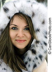 Lady in fur - Close-up beautiful young lady in fur cowl in...