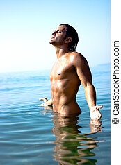 Male athlete in water - Male athlete with very muscular...