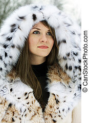 Lady in fur - Beautiful brunette lady in fur coat in the...