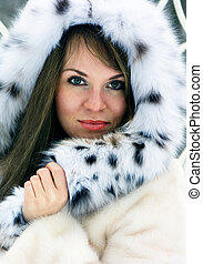 Lady in fur - Close-up beautiful brunette lady in fur cowl...