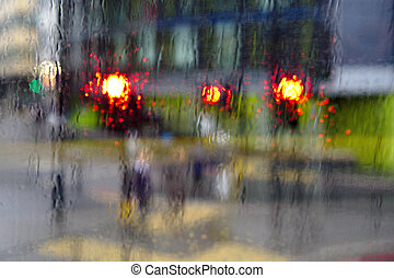 Rain Scene 1 - Red traffic lights through a rain soaked...